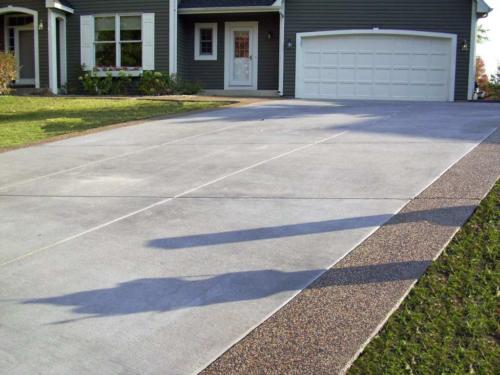 Lovely exposed aggregate concrete patio ideas Of Gray Brushed Concrete Driveway with Exposed Aggregate
